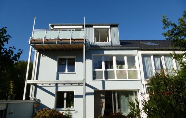 Ausbau Dachgeschoß zu Einliegerwohnung mit Balkon sowie Fassadendämmung, Rodenkirchen